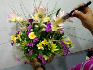 using a dry brush to clean floral arrangements